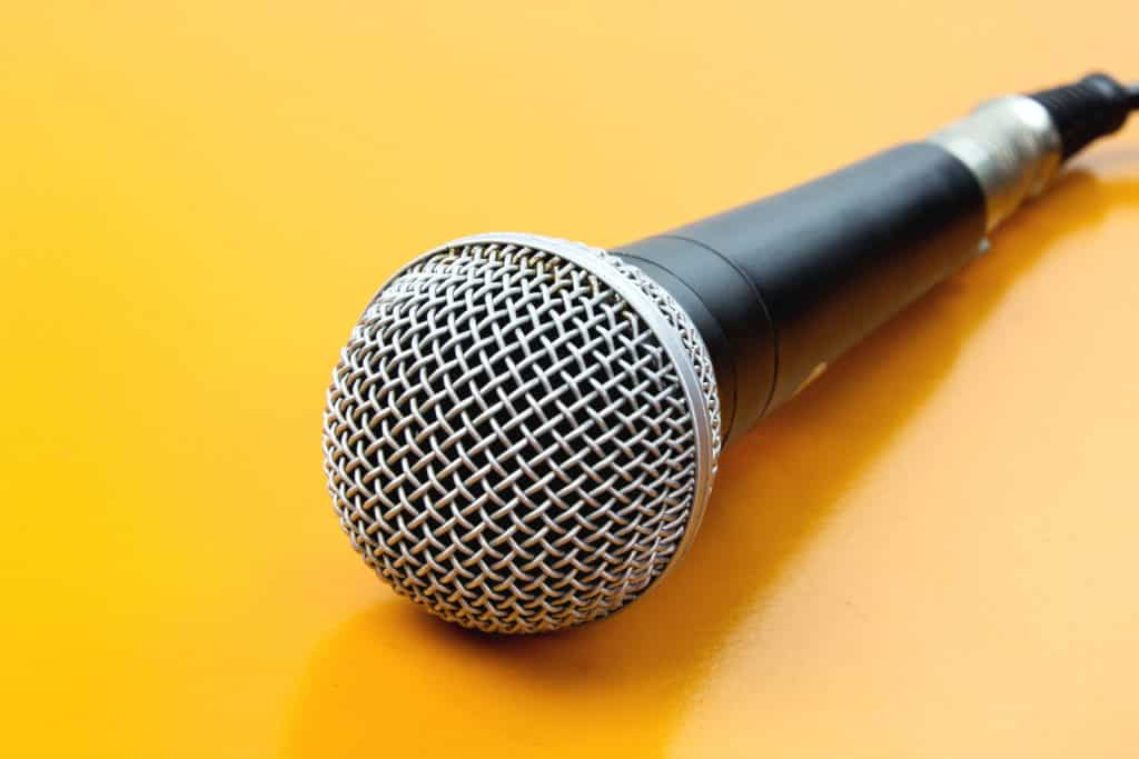 microphone on the table wooden yellow.