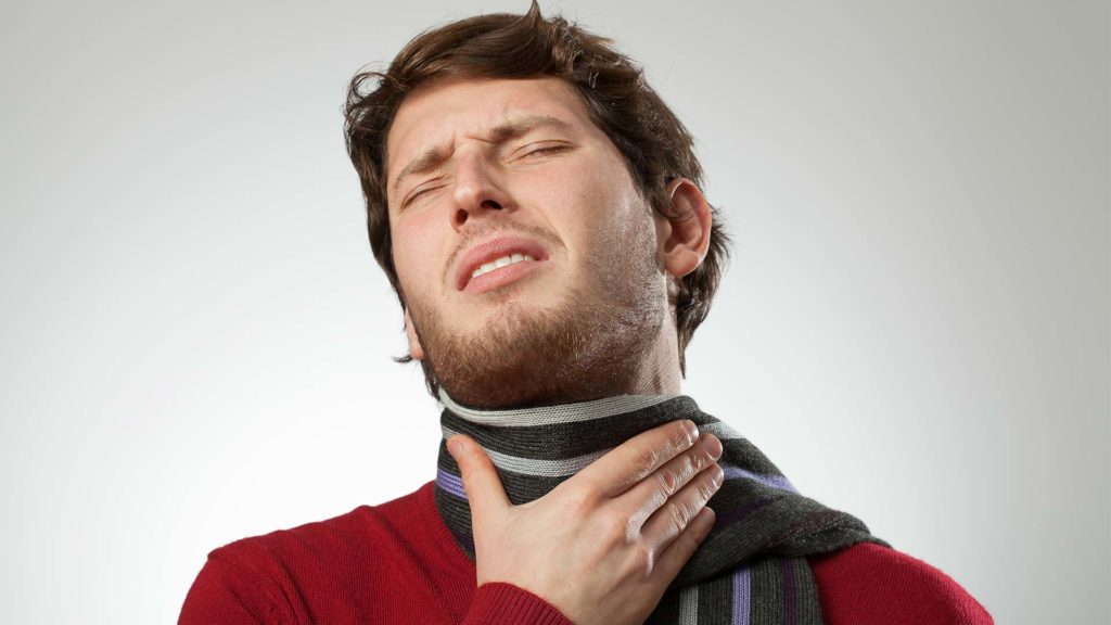 Man with sore throat because of vocal damage